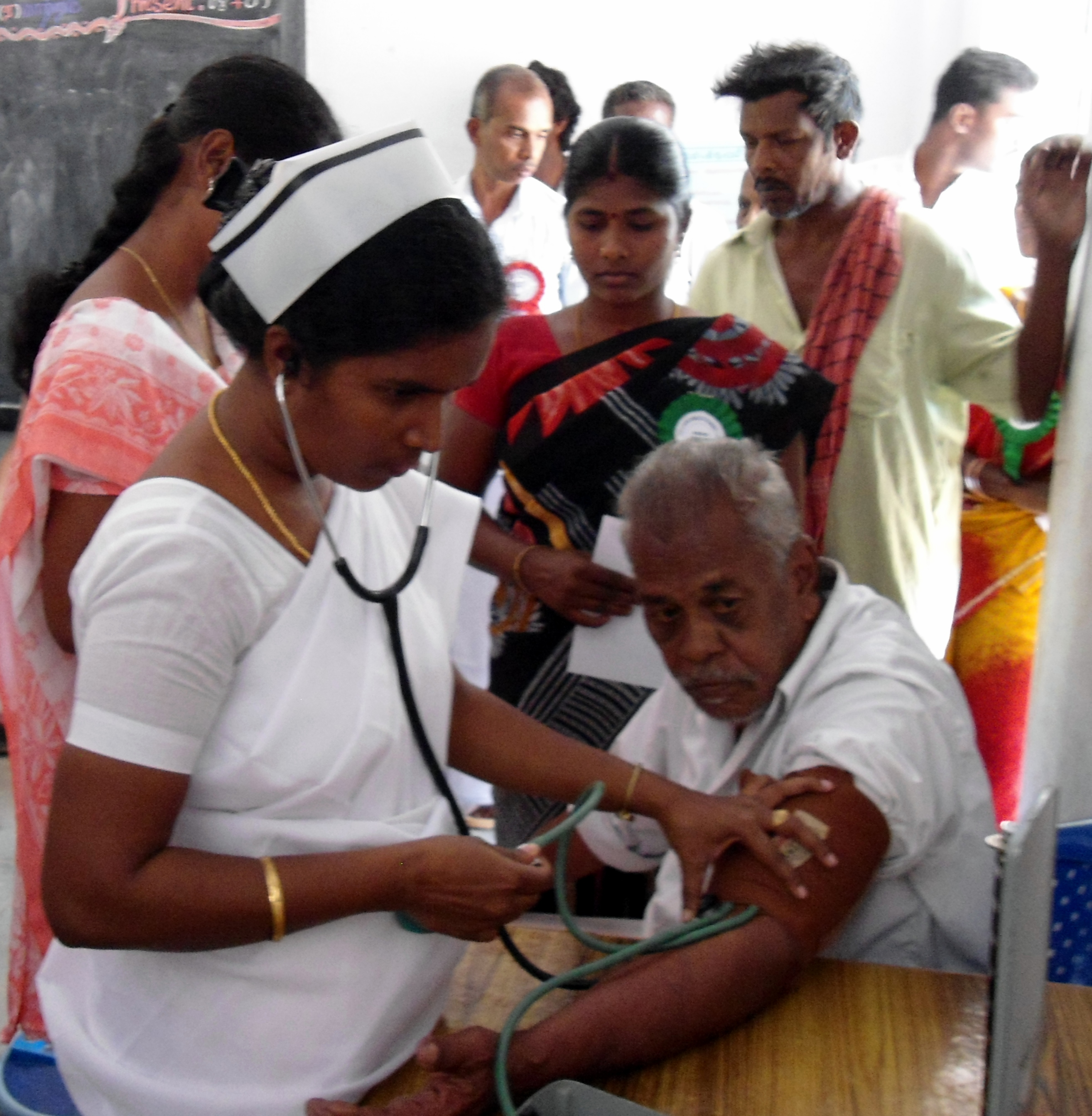 Villagers receiving health check