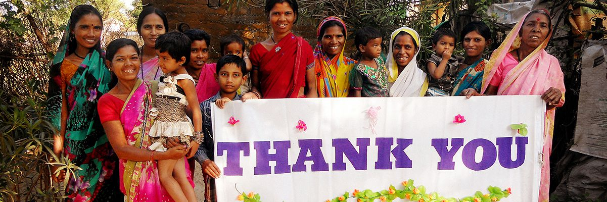 Group of Families Holding a Thank You sign